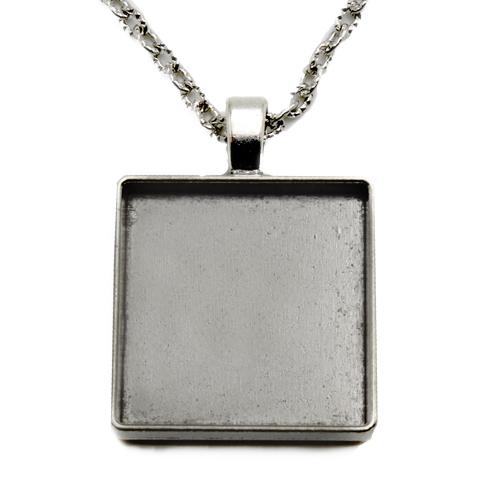 Antikolt ezüst kocka medál M20
